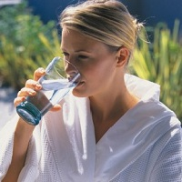 woman drinking ionized water